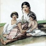 Kobieta z dwojgiem dzieci siedząca na ziemi